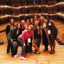 Karen in pink with speakers, getting ready before the 2014 event at Benaroya Hall in Seattle.