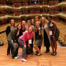 Karen in pink with speakers getting ready before the 2014 event at Benaroya Hall in Seattle.